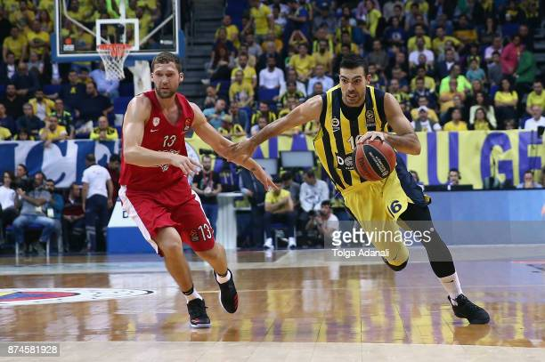 Kostas Sloukas #16 of Fenerbahce Dogus Istanbul and Janis Strelnieks #13 of Olympiacos Piraeus in action during the 2017/2018 Turkish Airlines...