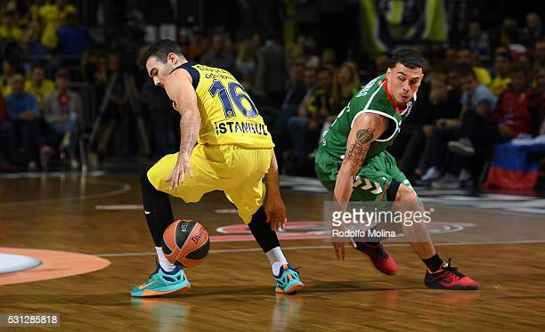 Kostas Sloukas #16 of Fenerbahce Istanbul competes with Mike James #3 of Laboral Kutxa Vitoria Gasteiz during Turkish Airlines Euroleague Final Four...