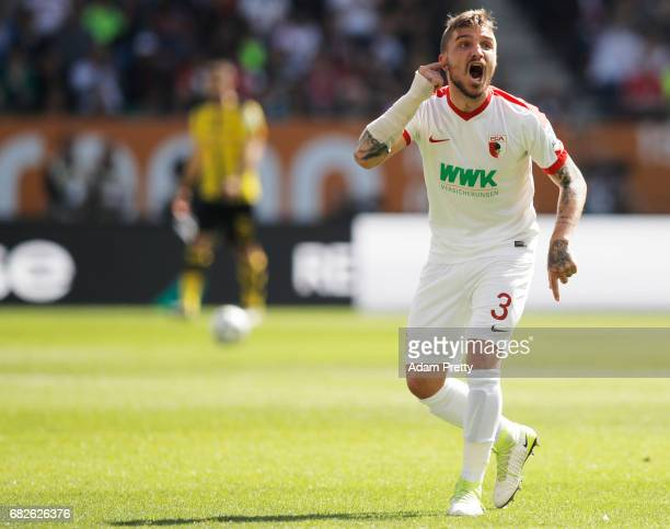 Kostas Stafylidis of Augsburg celebrates after the first goal during the Bundesliga match between FC Augsburg and Borussia Dortmund at WWK Arena on...
