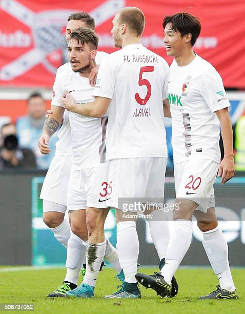 Kostas Stafylidis of Augsburg is congratulated after scoring a goal during the Bundesliga match between FC Ingolstadt and FC Augsburg at Audi...