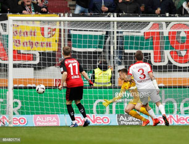 Kostas Stafylidis of Augsburg scores a goal during the Bundesliga match between FC Augsburg and SC Freiburg at WWK Arena on March 18 2017 in Augsburg...