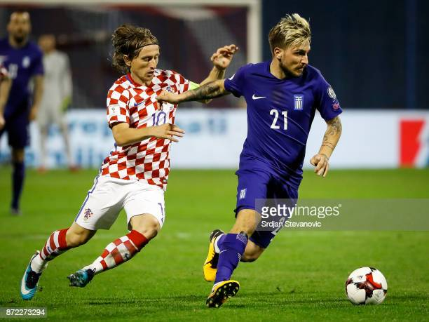 Kostas Stafylidis of Greece in action against Luka Modric of Croatia during the FIFA 2018 World Cup Qualifier PlayOff First Leg between Croatia and...