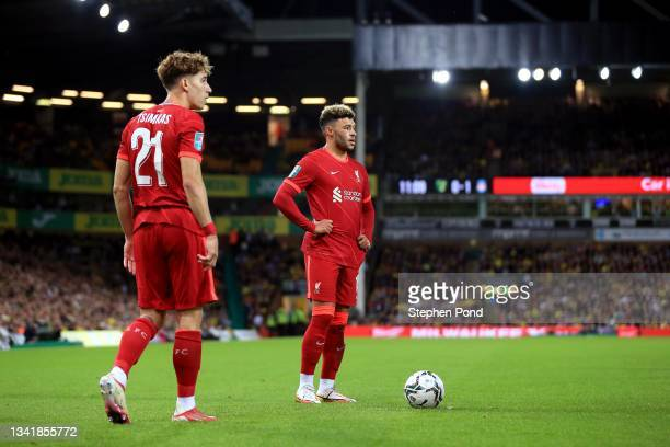 Kostas Tsimikas and Alex Oxlade-Chamberlain of Liverpool line up a free kick during the Carabao Cup Third Round match between Norwich City and...