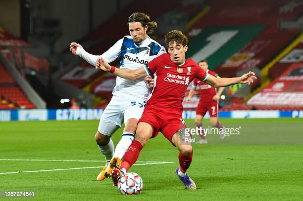 Kostas Tsimikas of Liverpool is challenged by Hans Hateboer of Atalanta B.C. During the UEFA Champions League Group D stage match between Liverpool...