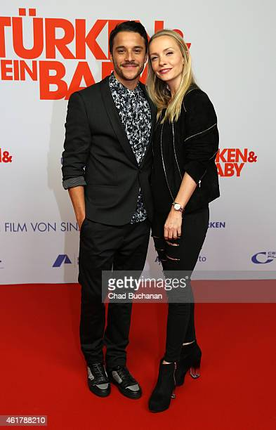 Kostja Ullmann and Janin Reinhardt pose on the red carpet during the '3 Tuerken Ein Baby' Berlin premiere on January 19 2015 in Berlin Germany