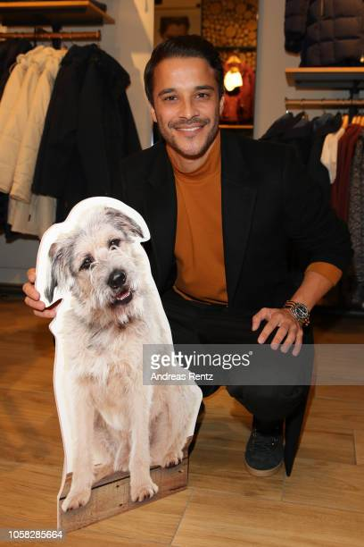 Kostja Ullmann attends the meet and greet at Jack Wolfskin flagship store prior to the movie premiere of 'Wuff' on October 22 2018 in Munich Germany