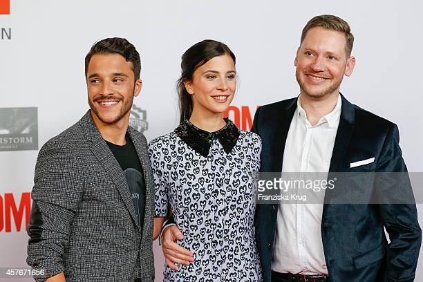 Kostja Ullmann Aylin Tezel and Marco Kreuzpaintner attend the 'Coming In' Premiere in Berlin on October 22 2014 in Berlin Germany