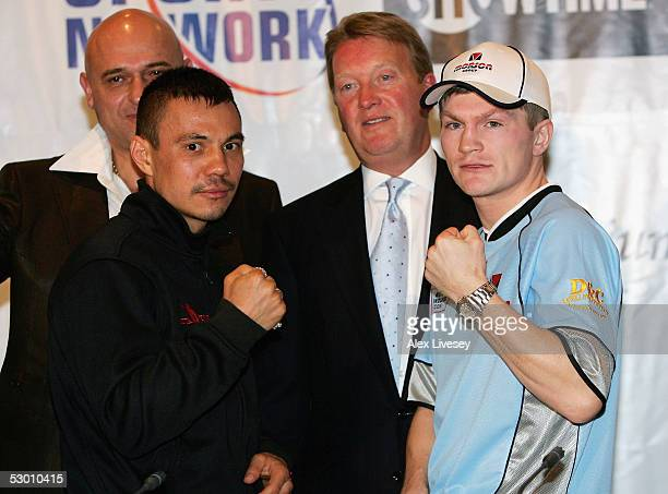 Kostya Tszyu of Australia and Ricky Hatton of England come head to head with promoter, Frank Warren after their press conference at the Radisson...