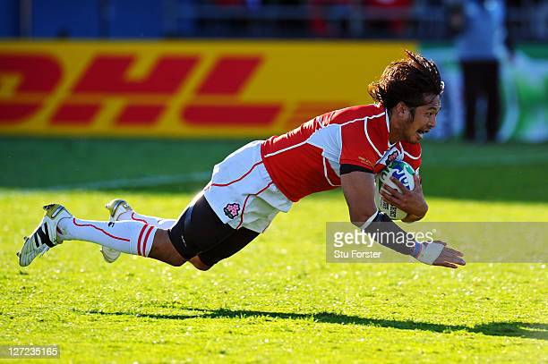 Kosuke Endo of Japan dives over the line to score his team's second try during the IRB 2011 Rugby World Cup Pool A match between Canada and Japan at...