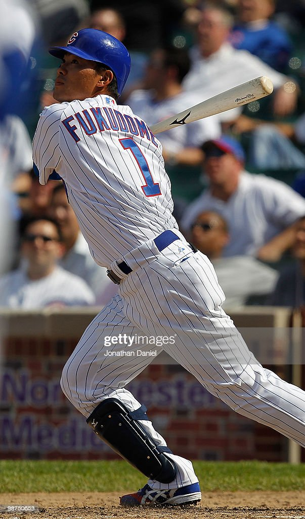 Kosuke Fukudome #1 of the Chicago Cubs hits a grand slam home run in the 8th inning against the Arizona Diamondbacks at Wrigley Field on April 29, 2010 in Chicago, Illinois. The Diamondbacks defeated the Cubs 13-5.