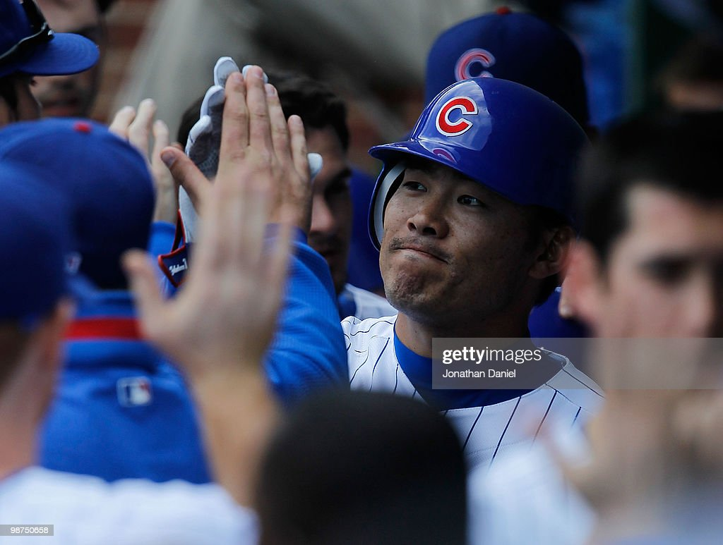 Kosuke Fukudome #1 of the Chicago Cubs is congratulated in the dugout by teammates after hitting a grand slam home run in the 8th inning against the Arizona Diamondbacks at Wrigley Field on April 29, 2010 in Chicago, Illinois. The Diamondbacks defeated the Cubs 13-5.
