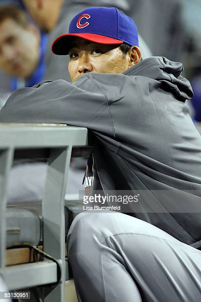 Kosuke Fukudome of the Chicago Cubs looks on from the dugout while the Cubs take on the Los Angeles Dodgers in Game Three of the NLDS during the 2008...