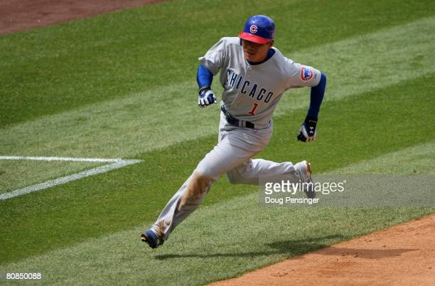 Kosuke Fukudome of the Chicago Cubs rounds third and heads home to score the Cubs first run on an RBI single by Felix Pie against the Colorado...