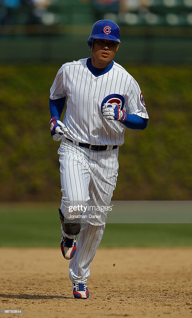 Kosuke Fukudome #1 of the Chicago Cubs runs the bases after hitting a grand slam home run in the 8th inning against the Arizona Diamondbacks at Wrigley Field on April 29, 2010 in Chicago, Illinois. The Diamondbacks defeated the Cubs 13-5.
