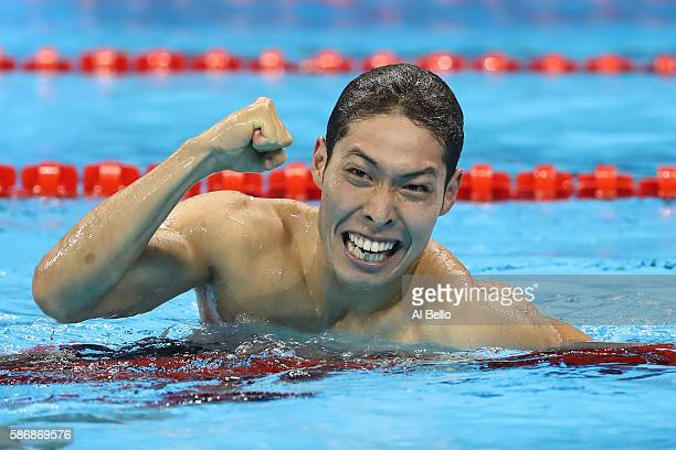 Kosuke Hagino of Japan celebrates winning gold in the Final of the Men's 400m Individual Medley on Day 1 of the Rio 2016 Olympic Games at the Olympic...