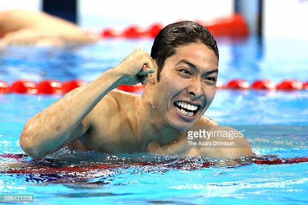 Kosuke Hagino of Japan celebrates winning gold in the Men's 400m Individual Medley on Day 1 of the Rio 2016 Olympic Games at the Olympic Aquatics...