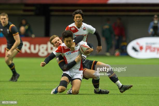 Kosuke Hashino of Japan is tackled by Ethan Davies of Wales during day 2 of the 2017 Canada Sevens Rugby Tournament on March 12 2017 in Vancouver...