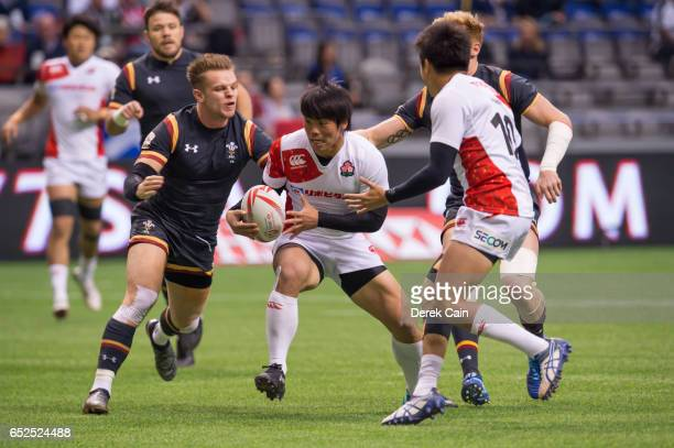 Kosuke Hashino of Japan runs past Ethan Davies of Wales during day 2 of the 2017 Canada Sevens Rugby Tournament on March 12 2017 in Vancouver British...