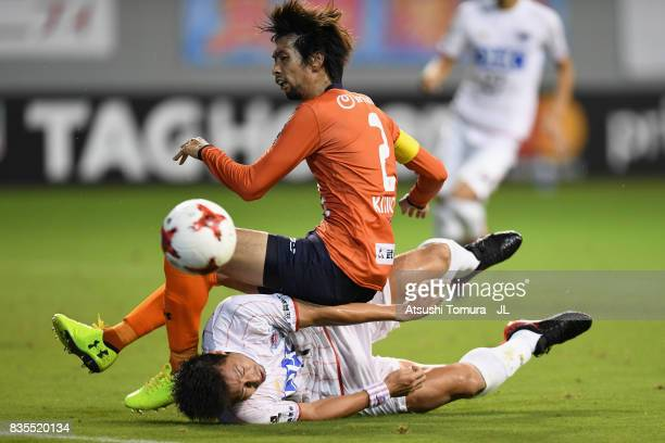 Kosuke Kikuchi of Omiya Ardija is tackled by Yohei Toyoda of Sagan Tosu during the JLeague J1 match between Sagan Tosu and Omiya Ardija at Best...