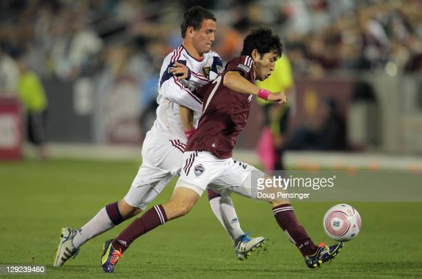 Kosuke Kimura of the Colorado Rapids controls the ball as Luis Gil of the Real Salt Lake pursues at Dick's Sporting Goods Park on October 14 2011 in...