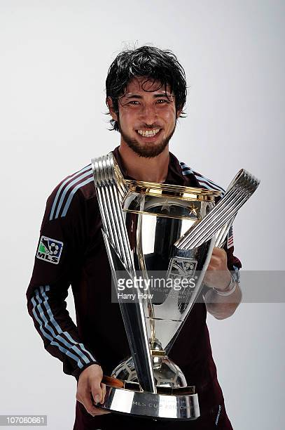 Kosuke Kimura of the Colorado Rapids poses with the Philip F Anschutz MLS Cup trophy following the MLS Cup final at BMO Field on November 21 2010 in...