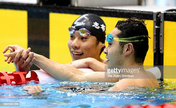 Kosuke Kitajima and Akihiro Yamaguchi shake hands after competing in the Men's 100m Breaststroke final during day one of the Japan Swim 2013 at Daiei...