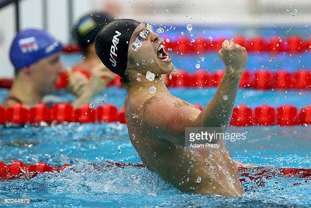 Kosuke Kitajima of Japan celebrates finishing the Men's 100m Breaststroke Final in first place and wins the gold medal held at the National Aquatics...