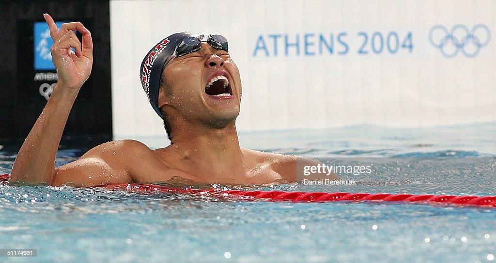 Kosuke Kitajima of Japan celebrates his world record and gold medal in the men's swimming 100 metre breaststroke final on August 15, 2004 during the Athens 2004 Summer Olympic Games at the Main Pool of the Olympic Sports Complex Aquatic Centre in Athens, Greece.