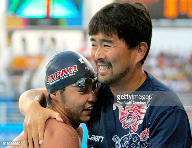 Kosuke Kitajima of Japan celebrates winning the gold in the Swimming Men's 200m Breaststroke with his coach Norimasa Hirai at the Athens Olympic...