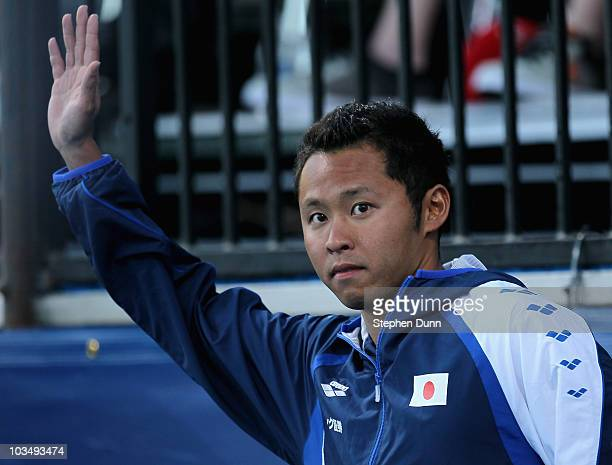 Kosuke Kitajima of Japan waves on the medal podium after winning gold in the mens 100m breaststroke final during the Mutual of Omaha Pan Pacific...