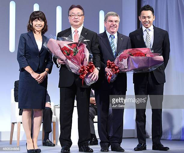 Kosuke Kitajima President of International Olympics Committee Thomas Bach Bridgestone CEO Masaaki Tsuya and Naoko Takahashi attend a news conference...