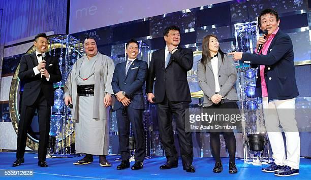 Kosuke Kitajima, sumo yokozuna Harumafuji, jodoka Tadahiro Nomura and HIdehiko Yoshida, wrestler Saori Yoshida and singer Nobuteru Maeda are seen on...
