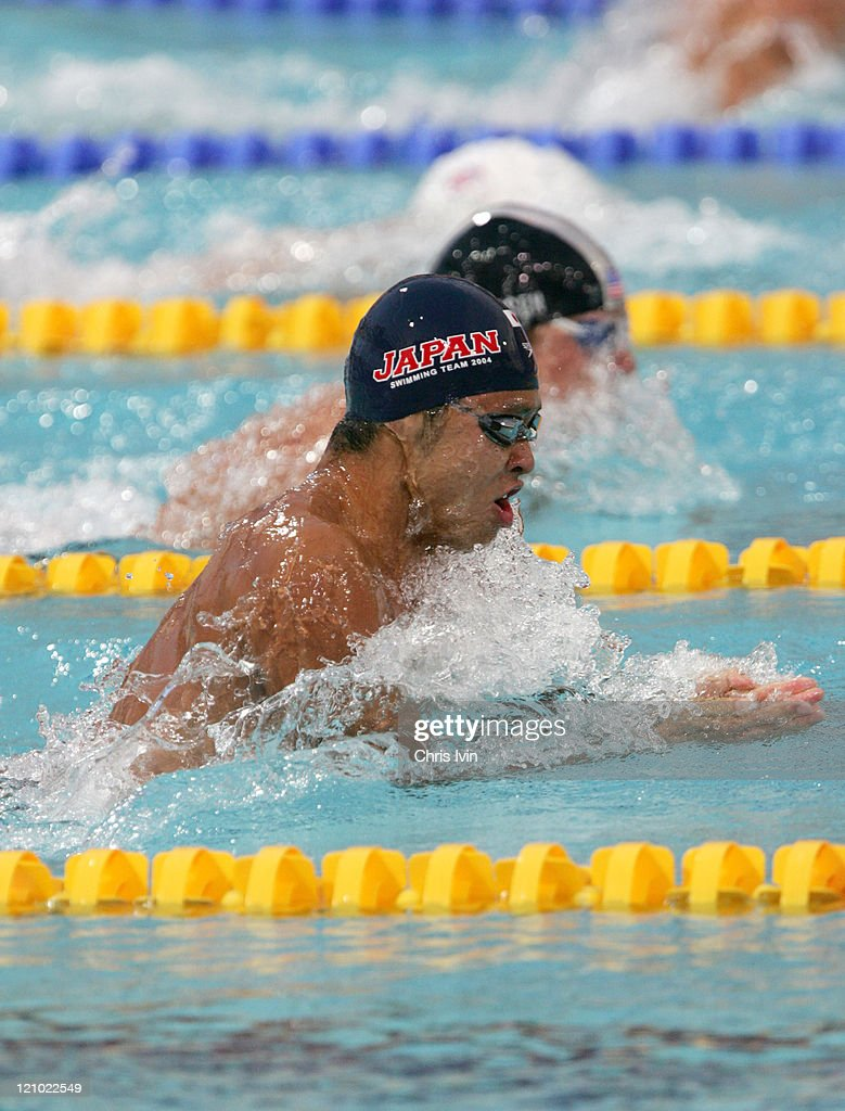 Kosuke Kitajima (JPN) wins the Men's 100-meter Breaststroke Final in a time of 1:00.08 at the Athens Olympics.