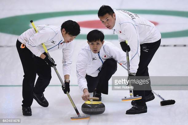 Kosuke Morozumi of Japan places a stone during the preliminary round of the men's curling against Chinese Taipei on the day one of the 2017 Sapporo...