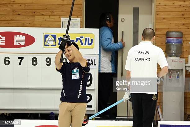 Kosuke Morozumi of SC Karuizawa celebrates after winning against Sapporo during Game Three of the Curling Japan Qualifying Tournament between SC...