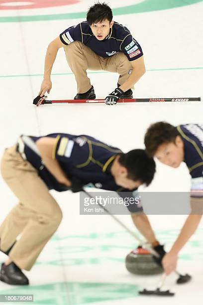 Kosuke Morozumi of SC Karuizawa looks on after he throws a stones during Game Two of the Curling Japan Qualifying Tournament between SC Karuizawa and...