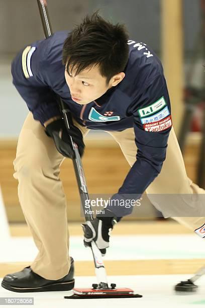 Kosuke Morozumi of SC Karuizawa sweeps during Game Three of the Curling Japan Qualifying Tournament between SC Karuizawa and Sapporo at Dohgin...