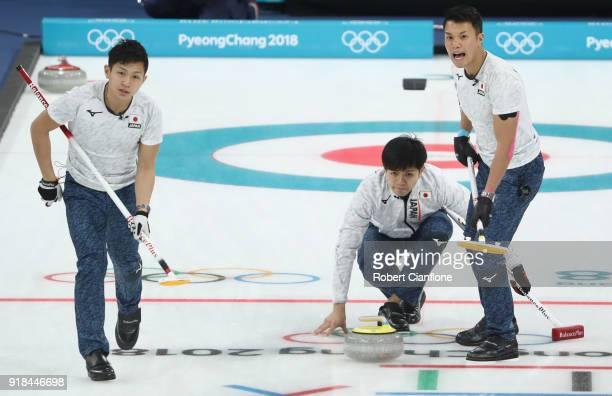 Kosuke Morzumi Yusuke Morozumi and Tsuyoshi Yamaguchi of Japan compete during the Curling Men's Round Robin Session 3 held at Gangneung Curling...