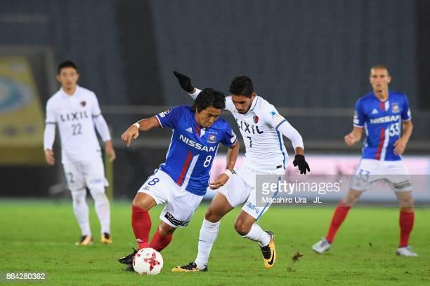 Kosuke Nakamachi of Yokohama FMarinos controls the ball under pressure Pedro Junior of Kashima Antlersduring the JLeague J1 match between Yokohama...