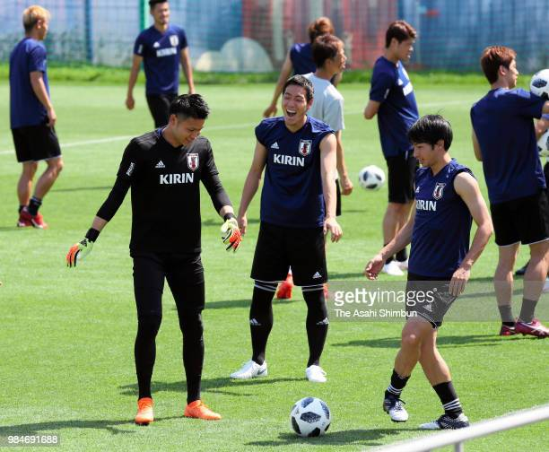 Kosuke Nakamura Gen Shoji and Gaku Shibasaki of Japan warm up during the Japan training session on June 26 2018 in Kazan Russia