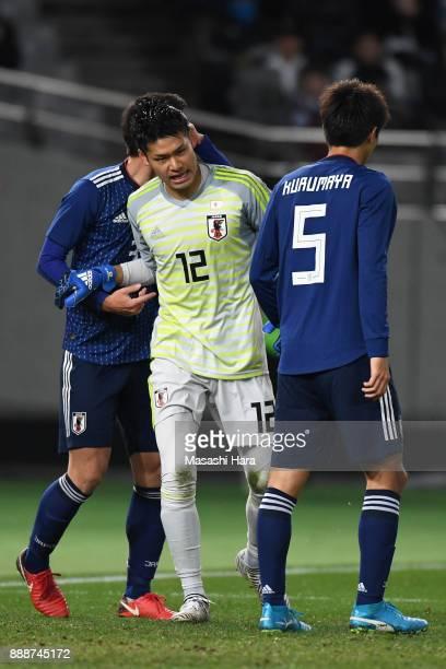 Kosuke Nakamura of Japan is congratulated by his team mates during the EAFF E1 Men's Football Championship between Japan and North Korea at Ajinomoto...