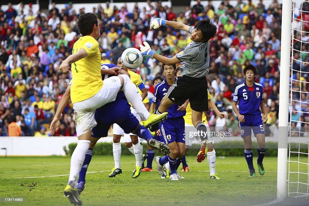 Kosuke Nakamura of Japan struggles for the ball with Lucas Piazon (L) of Brazil during the FIFA U17 World Cup Mexico 2011 Quarter Final match between Japan and Brazil at the La Corregidora Stadium on July 03, 2011 in Queretaro, Mexico.