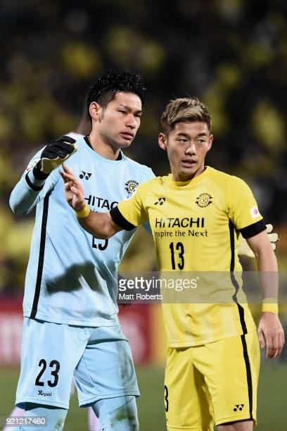 Kosuke Nakamura of Kashiwa Reysol is congratulated by his team mate Ryuta Koike during the AFC Champions League match between Kashiwa Reysol and...
