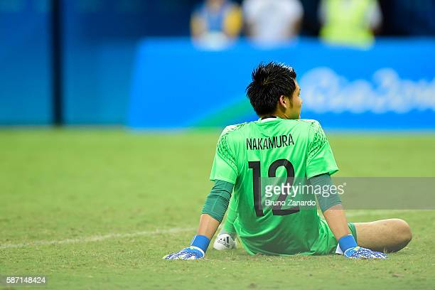 Kosuke Nakamura player of Japan goes to ground after a goal during 2016 Summer Olympics match between Japan and Colombia at Arena Amazonia on August...