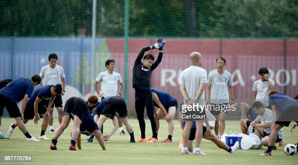 Kosuke Nakamura stretches during a Japan training session at FC Rubin Kazan training ground on June 30 2018 in Kazan Russia