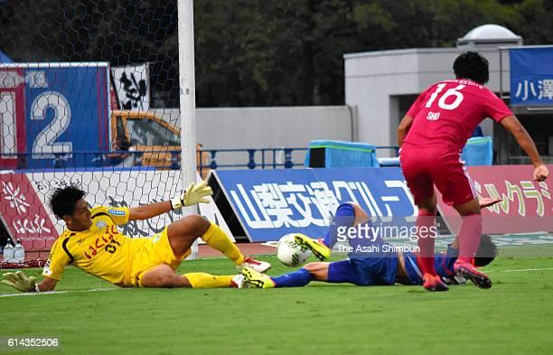 Kosuke Okanishi of Ventforet Kofu makes a save a shot by Sho Ito of Yokohama FMarinos during the JLeague match between Ventforet Kofu and Yokohama...