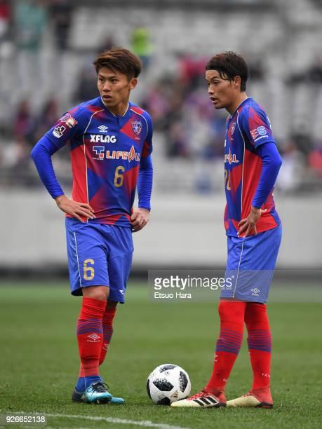 Kosuke Ota and Keigo Higashi of FC Tokyo are seen during the JLeague J1 match between FC Tokyo and Vegalta Sendai at Ajinomoto Stadium on March 3...