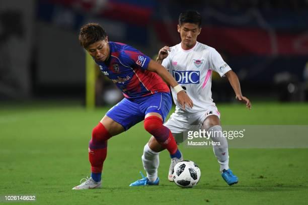 Kosuke Ota of FC Tokyo and Akito Fukuta of Sagan Tosu compete for the ball during the JLeague J1 match between FC Tokyo and Sagan Tosu at Ajinomoto...