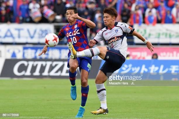 Kosuke Ota of FC Tokyo and Dudu of Ventforet Kofu compete for the ball during the JLeague J1 match between Ventforet Kofu and FC Tokyo at Yamanashi...
