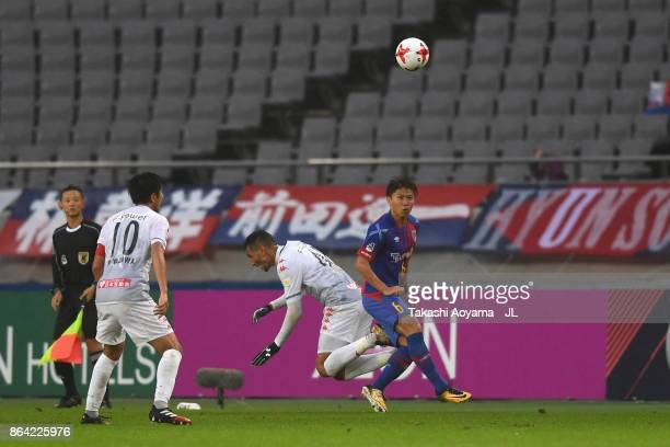 Kosuke Ota of FC Tokyo and Jay Bothroyd of Consadole Sapporo compete for the ball during the JLeague J1 match between FC Tokyo and Consadole Sapporo...